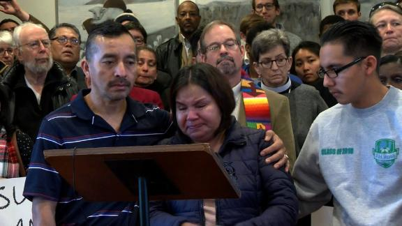 Samuel Oliver-Bruno stands with his wife and son during a press conference announcing he would be seeking sanctuary at City Well United Methodist Church in December 2017.