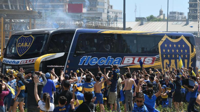Fans gathered outside a hotel in Buenos Aires to great Boca Juniors players on the way match.