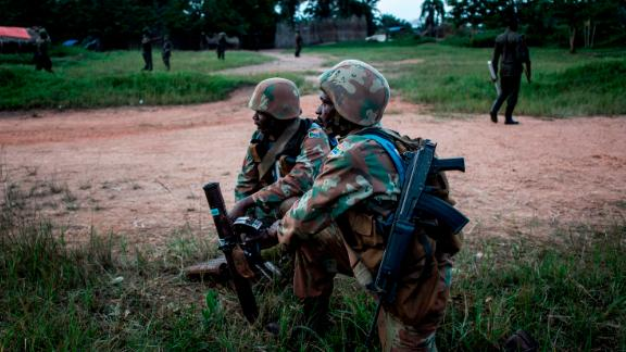 South African soldiers from the UN Stabilization Mission in the Democratic Republic of the Congo set up a mortar position October 7 in Oicha.