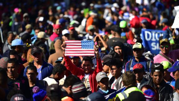 Central American migrants -mostly from Honduras- wanting to reach the United States in hope of a better life, are stopped by federal police officers before arriving at El Chaparral port of entry in the US-Mexico border, in Tijuana, Baja California State, Mexico on November 25, 2018. (Photo by Pedro Pardo / AFP)        (Photo credit should read PEDRO PARDO/AFP/Getty Images)