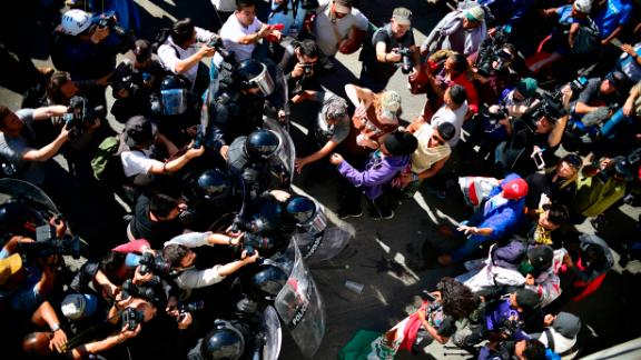 Migrants are stopped by Mexican police officers.