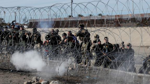 US Border Patrol agents fire tear gas toward migrants at the border.