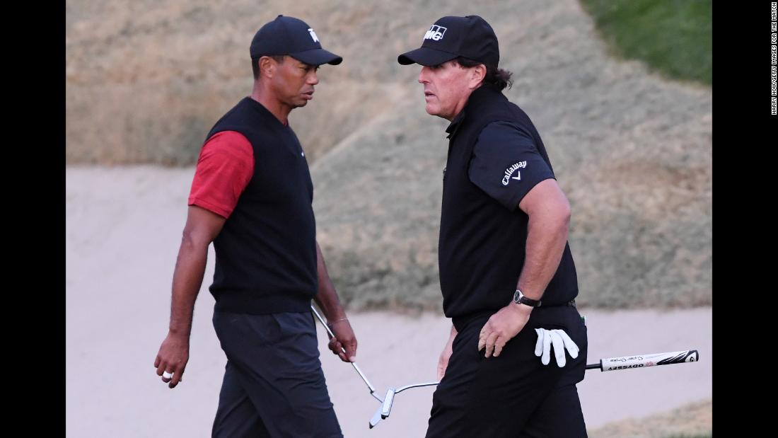 Tiger Woods and Phil Mickelson walk on the 18th hole during The Match: Tiger vs Phil on Friday, November 23, in Las Vegas. Mickelson defeated Woods in 22 holes.