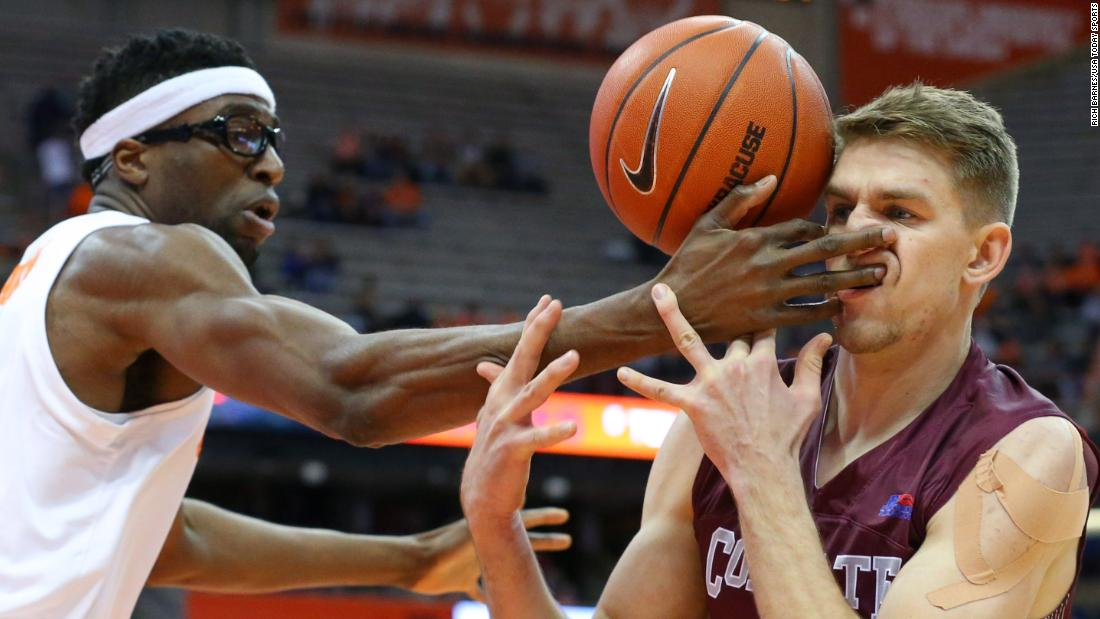 Syracuse Orange center Paschal Chukwu hits Colgate Raiders forward Rapolas Ivanauskas in the face while reaching for a loose ball during the first half of a game on Wednesday, November 21 in Syracuse, New York.