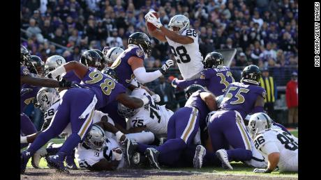 Raiders running back Doug Martin leaps for a touchdown against the Baltimore Ravens.