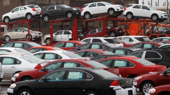 FILE PHOTO: Newly built cars sit in a shipping lot near  General Motors Car assembly plant in Oshawa, June 1, 2012. REUTERS/Mark Blinch/File Photo