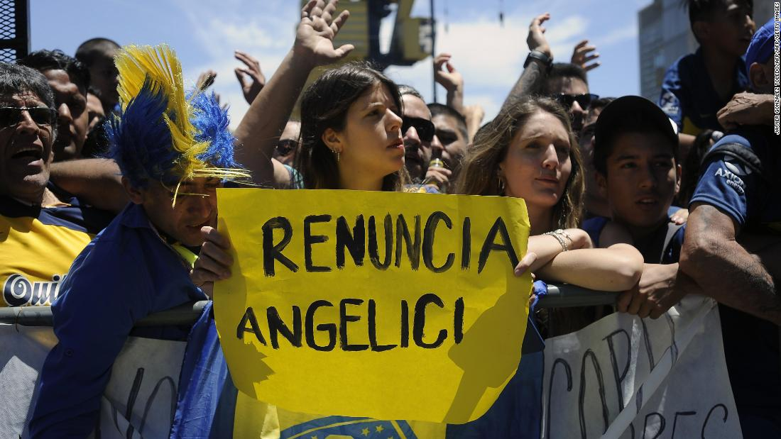 Boca Juniors fans gathered outside the team hotel in support, but some were demanding the resignation of club president Daniel Angelici after he had signed an agreement for the game to go ahead, despite several players being hospitalized.