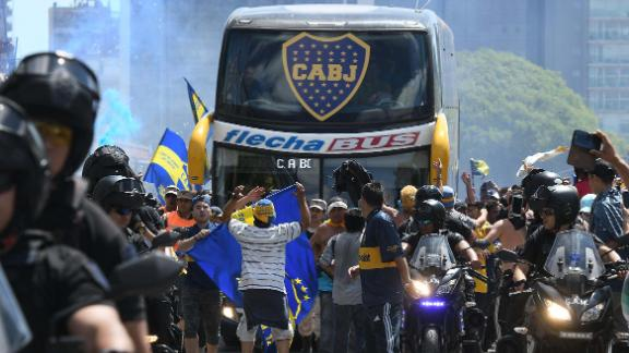 Picture released by Telam showing the Boca Juniors team bus leaving their hotel on the way to the Monumental stadium in Buenos Aires on Saturday before it was attacked.