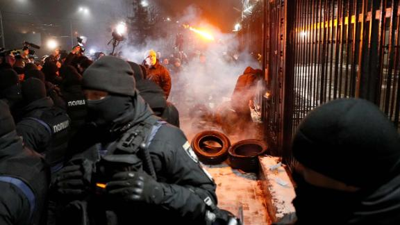Protesters gather outside the Russian embassy in Kiev on Sunday evening.