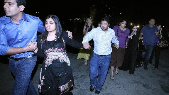 Indian and foreign guests rush out of the Taj Mahal hotel, as news of the attack breaks out.