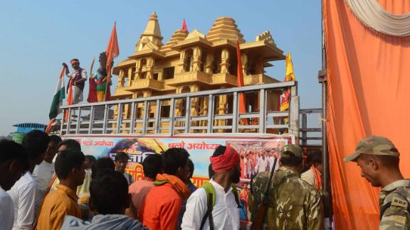 Indian people watch a model of the Ram temple during the 'Dharam Sabha' Hindu congregation held to call for the construction of a grand temple of Lord Rama, in Ayodhya on November 25, 2018. - Hindu groups claim deity Rama was born and a temple existed at the site of a medieval Mosque that was demolished by Hindu mobs in 1992, triggering religious riots that left some 2,000 people dead across India. The more than a century-old dispute over the site has been a frequent  flashpoint between majority Hindus and minority Muslims. (Photo by SANJAY KANOJIA / AFP)        (Photo credit should read SANJAY KANOJIA/AFP/Getty Images)