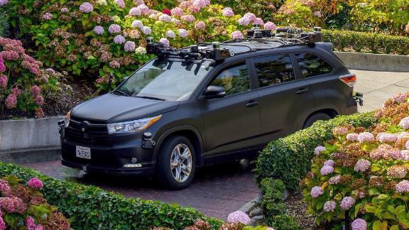 A Zoox vehicle navigates down a street in San Francisco.
