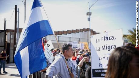 Migrants may have to wait 6 weeks at the border to seek asylum, the official says