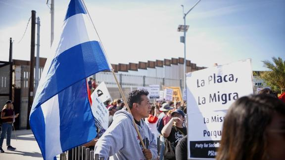 Protesters march along the United States-Mexico border during a rally to show solidarity with the migrant caravan on November 25, 2018. - US officials closed the border crossing in southern California on Sunday after hundreds of migrants tried to breach a fence from the Mexican city of Tijuana, US authorities announced on Sunday. (Photo by Sandy Huffaker / AFP)        (Photo credit should read SANDY HUFFAKER/AFP/Getty Images)