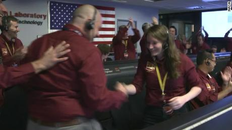 This epic NASA handshake was inspired by NFL players