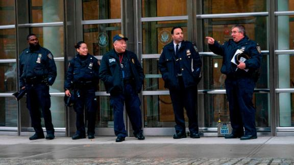 "Police patrol near a box used for monitoring multiple threat detection during the start of jury selection for the ""El Chapo"" trial at Brooklyn Federal Court in New York."