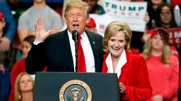 President Donald Trump encourages voters to support Sen. Cindy Hyde-Smith in runoff race against Democrat Mike Espy at a rally Monday, Nov. 26, 2018, in Biloxi, Miss. (AP Photo/Rogelio V. Solis)