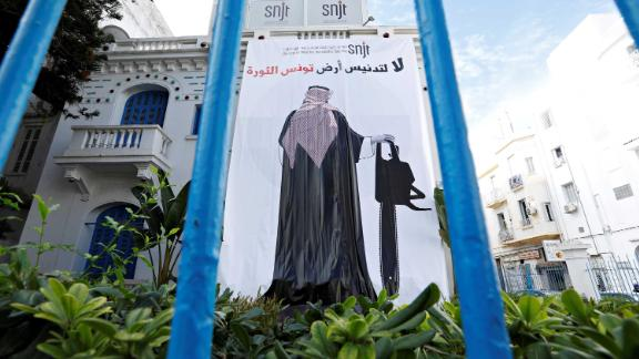 A banner depicting an image of Saudi Crown Prince Mohammed bin Salman holding a chainsaw, is seen near the Union of Tunisian Journalists headquarters in Tunis, Tunisia.