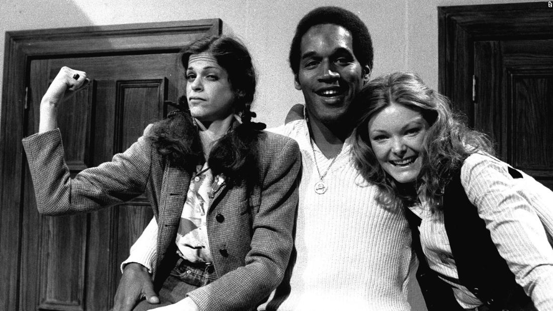 """O.J. Simpson -- the second athlete to host """"Saturday Night Live"""" -- posing with Radner and Curtin in 1978 during the show's third season."""
