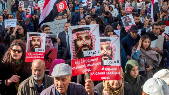 Tunisians demonstrate with placards reading 'You are not welcomed' and showing Saudi Crown Prince Mohammed bin Salman, Tuesday Nov.27, 2018 in Tunis.