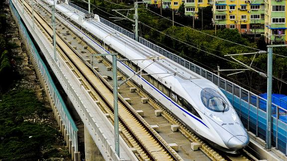 A Chinese high-speed train leaves the station in Shanghai on October 26, 2010 after the launch of the Shanghai to Hangzhou line. China's latest new high-speed passenger rail line went into service, halving travel time to 45 minutes between Shanghai and the eastern lake city of Hangzhou, officials said.           CHINA OUT        AFP PHOTO (Photo credit should read STR/AFP/Getty Images)