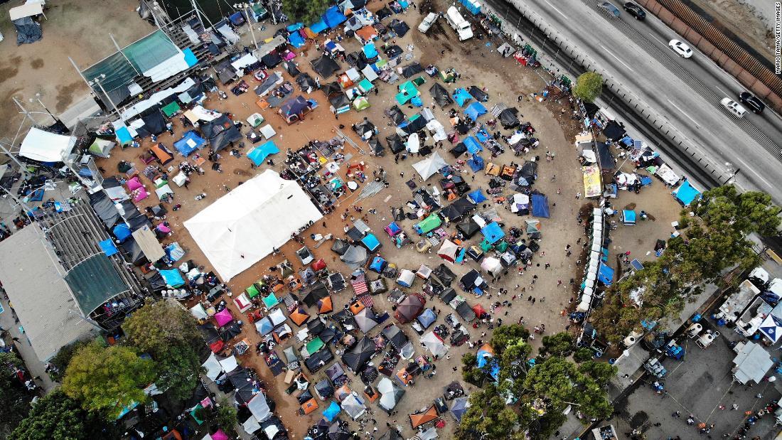 Migrants begin arriving at new Tijuana shelter