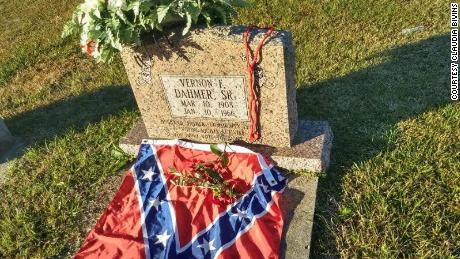Bivins said he placed the flag on Vernon Dahmer's grave as a gesture of hope for the end of racism.