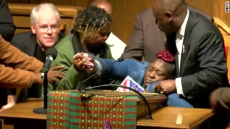 Emantic Bradford Jr.'s mother faints at a prayer meeting for him