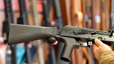 A bump stock device, (left) that fits on a semi-automatic rifle to increase the firing speed, making it similar to a fully automatic rifle, is installed on a AK-47 semi-automatic rifle, (right) at a gun store on October 5, 2017 in Salt Lake City, Utah. (George Frey/Getty Images)