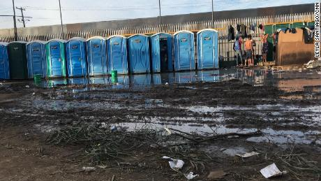 Wastewater and portable toilets drain a nearby field at Benito Juarez Sports Complex in Tijuana, Mexico, where thousands of immigrants have been sheltered while waiting to seek asylum in the United States.