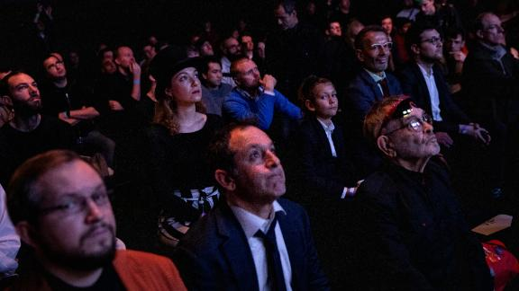 The crowd watch  Fabiano Caruana and Magnus Carlsen take part in the final