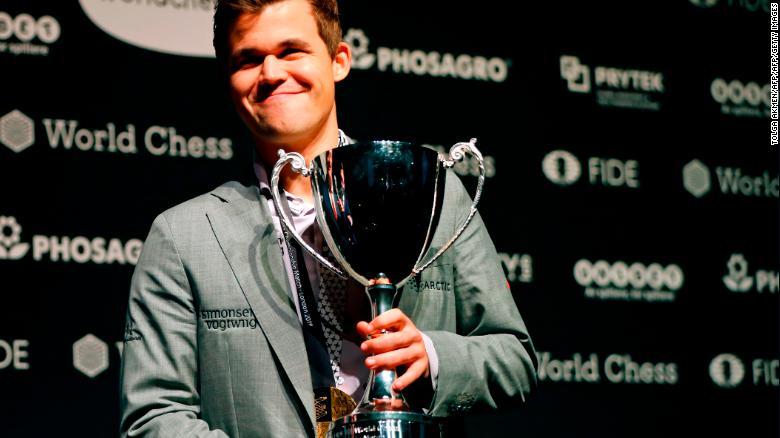 Carlsen with the FIDE world chess championship trophy after beating challenger, US player Fabiano Caruana (not pictured).