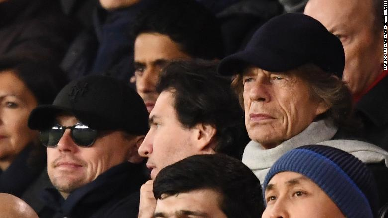 Actor Leonardo DiCaprio (sunglasses) and singer Mick Jagger (right) watched PSG beat Liverpool in the Champions League.