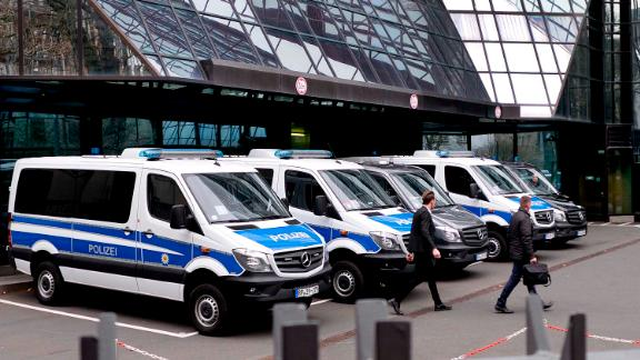 Police officers walk in the backyard of Deutsche Bank headquarters during a raid in Frankfurt, Germany, Thursday, Nov. 29, 2018. (AP Photo/Michael Probst)