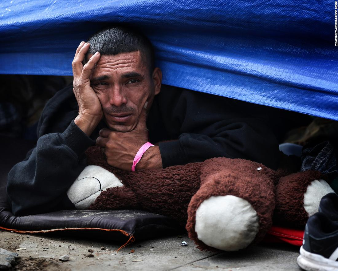 A migrant rests in his tent at the Benito Juarez Sports Complex, which is now a makeshift shelter in Tijuana, Mexico.