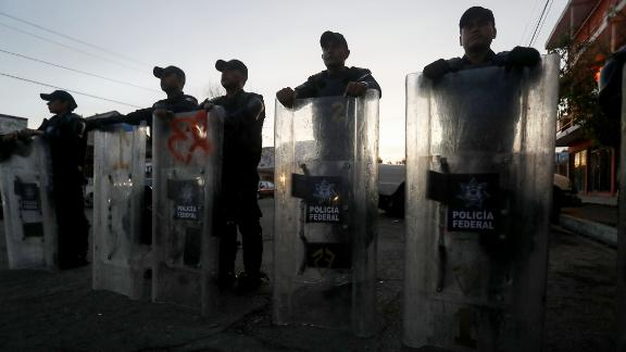 Mexican Federal Police keep watch outside the shelter.