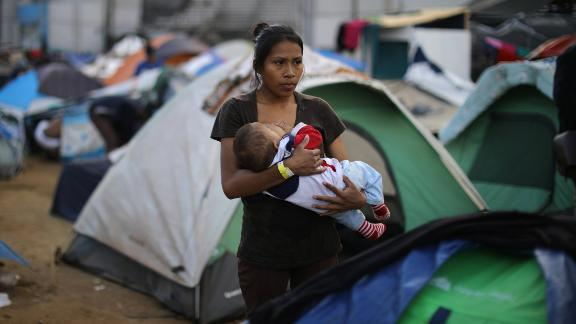 Jessica Perez, an 18-year-old from El Salvador, nurses her 6-month-old son, Giovanni.