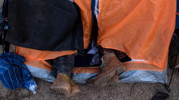 Many staying in the shelter are sleeping outdoors -- some in tents, some lying on the dirt in sleeping bags or blankets.