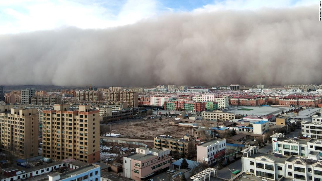 A sandstorm hits the Chinese city of Zhangye on Sunday, November 25.