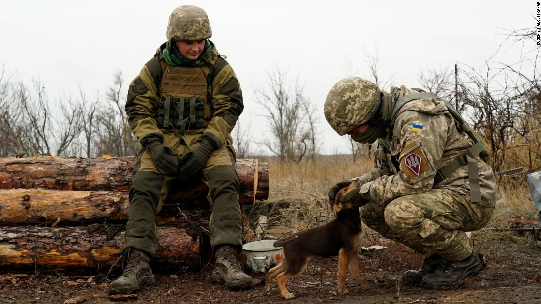 "Ukrainian soldiers pet a puppy as they control an area near Shyrokyne, Ukraine, on Wednesday, November 28. Ukrainian President Petro Poroshenko warned that his country's simmering conflict with Russia could quickly spiral into full-scale confrontation following <a href=""https://www.cnn.com/2018/11/27/europe/russia-ukraine-kerch-strait-intl/index.html"" target=""_blank"">a maritime clash between the two countries.</a>"