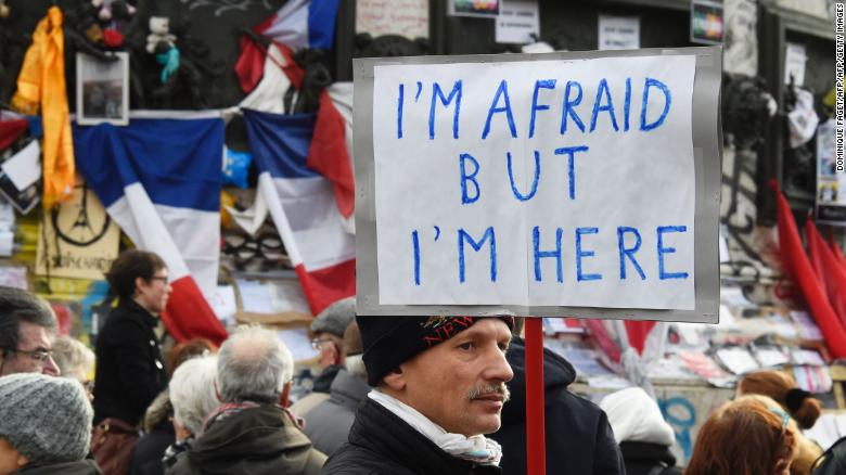 "Anti-Semitism has surged in recent years in France. A man holds a placard reading ""I am afraid but I am here"" during a gathering on Place de la Republique in January 10, 2016 in Paris."