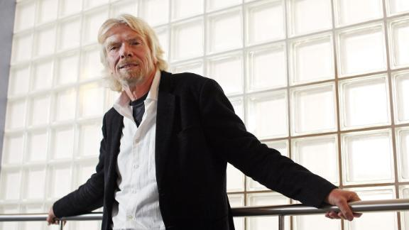 FILE: Richard Branson, the founder of Virgin Group Ltd., poses for a photograph at the Virgin Money headquarters in Gosforth, near Newcastle, U.K., on Monday, Jan. 9, 2012. CYBG Plc agreed to buy Virgin Money Holdings U.K. Plc for about 1.7 billion pounds ($2.3 billion) in an all-stock transaction, creating a bank with about 6 million customers to challenge Britains largest lenders. Our editors select the best archive images of Virgin Money, Richard Branson, David Duffy, and Jayne-Anne Gadhia. Photographer: Chris Ratcliffe/Bloomberg via Getty Images