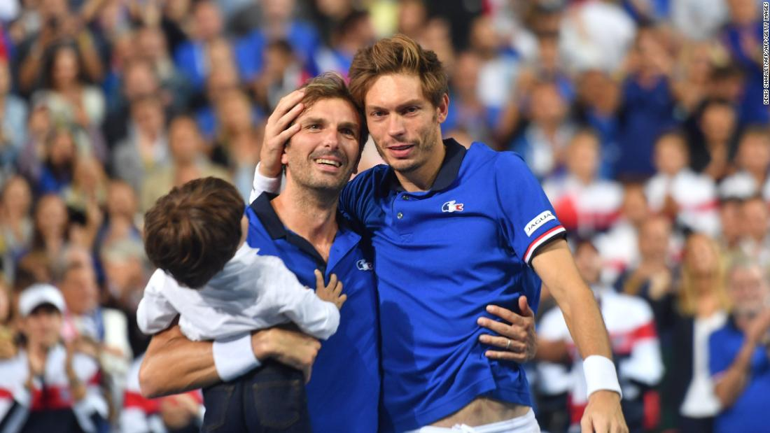 In his farewell Davis Cup outing in September, Benneteau (seen here with his son) and Nicolas Mahut won in doubles against Spain.