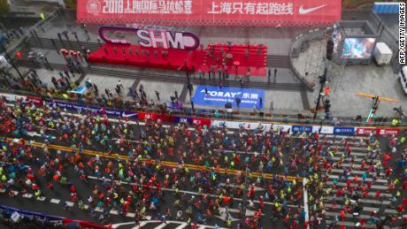 Marathons are increasingly common and popular in China. Runners in this photo take part in the Shanghai International Marathon in Shanghai on November 18.