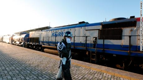 South Korea sent rail cars and dozens of officials to North Korea on Friday for joint surveys on northern railway sections the countries hope someday to connect with the South.