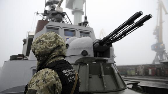 """TOPSHOT - Ukrainian soldier patrols aboard military boat called """"Dondass"""" moored in Mariupol, Sea of Azov port on November 27, 2018. - Three Ukrainian navy vessels were seized off the coast of Crimea by Russian forces, which fired on and boarded Kiev's ships after several tense hours of confrontation. Here's what is known about Sunday's incident. (Photo by Sega VOLSKII / AFP)        (Photo credit should read SEGA VOLSKII/AFP/Getty Images)"""