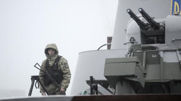 """Ukrainian soldier patrols aboard military boat called """"Dondass"""" moored in Mariupol, Sea of Azov port on November 27, 2018."""