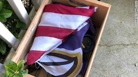 Gail Cook's FedEx driver folded their fallen American flag respectfully and left it in a box on their porch.