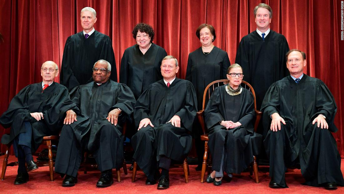 The US Supreme Court, with newest member Brett Kavanaugh, poses for an official portrait in Washington in November 2018. In the back row, from left, are Neil Gorsuch, Sonia Sotomayor, Elena Kagan and Kavanaugh. In the front row, from left, are Stephen Breyer, Clarence Thomas, Chief Justice John Roberts, Ginsburg and Samuel Alito.