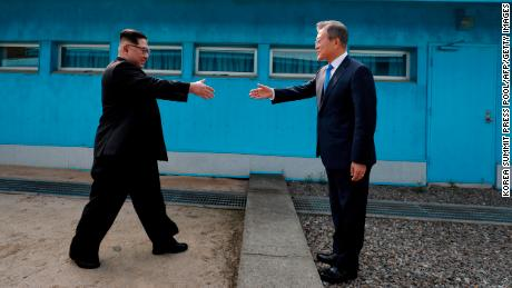 North Korea's leader Kim Jong Un (L) shakes hands with South Korea's President Moon Jae-in (R) at the Military Demarcation Line that divides their countries ahead of their summit at the truce village of Panmunjom on April 27, 2018. - North Korean leader Kim Jong Un and the South's President Moon Jae-in sat down to a historic summit on April 27 after shaking hands over the Military Demarcation Line that divides their countries in a gesture laden with symbolism. (Photo by Korea Summit Press Pool / Korea Summit Press Pool / AFP)        (Photo credit should read KOREA SUMMIT PRESS POOL/AFP/Getty Images)